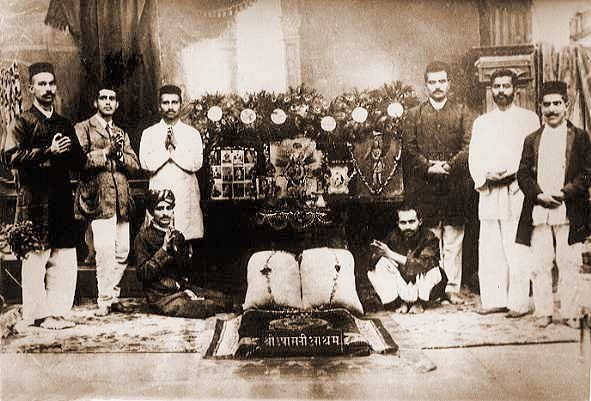 Merwan seated left, with his early companions